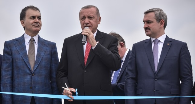 President Recep Tayyip Erdoğan (C) speaks at a collective opening ceremony in Istanbul, June 19, 2019.