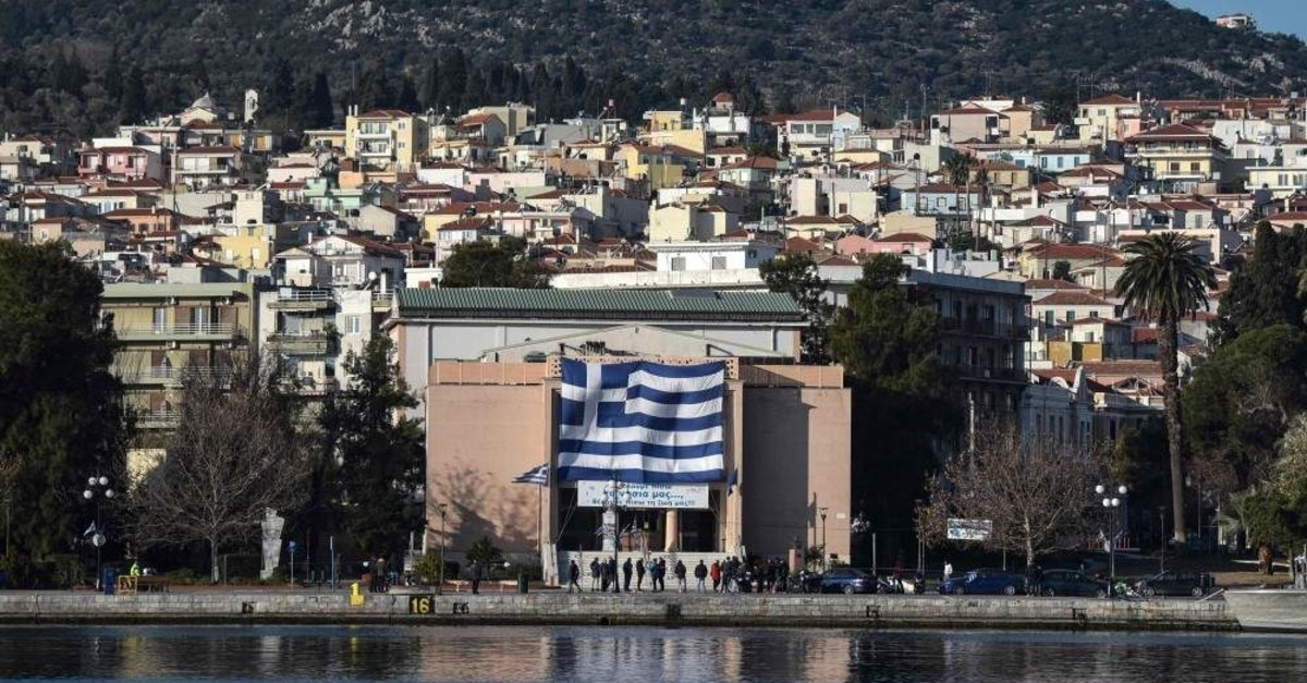 A big national Greek flag hanging on the facade of the municipal theater of Mytilene on the island of Greek island of Lesbos on Jan. 22, 2020. (AFP Photo)