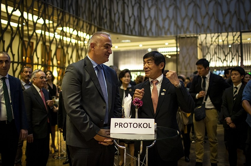 Culture and Tourism Minister Mehmet Ersoy (L) chats with Japanese Ambassador Akio Miyajima at reception marking Japanese Autumn Festival 2018. (AA Photo)
