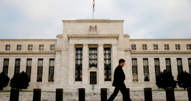 A man walks past the Federal Reserve Bank in Washington, D.C., U.S. December 16, 2015 (Reuters File Photo)