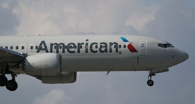 An American Airlines Boeing 737 Max 8, on a flight from Miami to New York City, comes in for landing at LaGuardia Airport in New York, March 12, 2019. (AFP Photo)