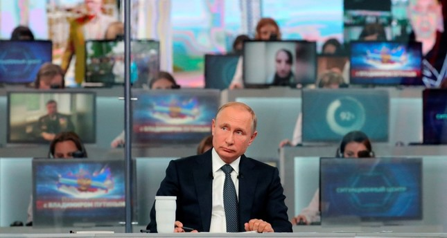 Russian President Vladimir Putin listens to a question during his annual call-in show in Moscow, Russia, Thursday, June 7, 2018. (AP Photo)