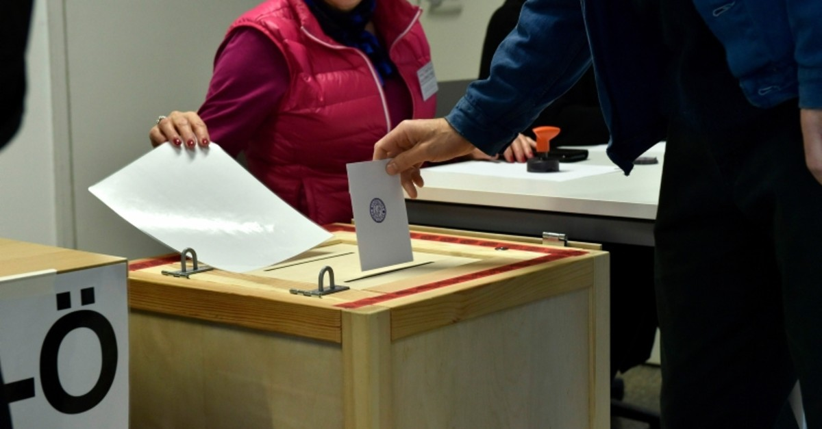 A man casts his vote in the parliamentary elections in Helsinki Finland on Sunday April 14, 2019. (AP Photo)