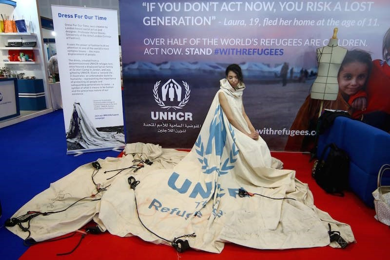 Project ambassador of ,Dress For Our Time, Louise Owen models a UN tent from the Zaatari camp in Jordan that has been converted into a dress by fashion academic Helen Storey. (AFP Photo)