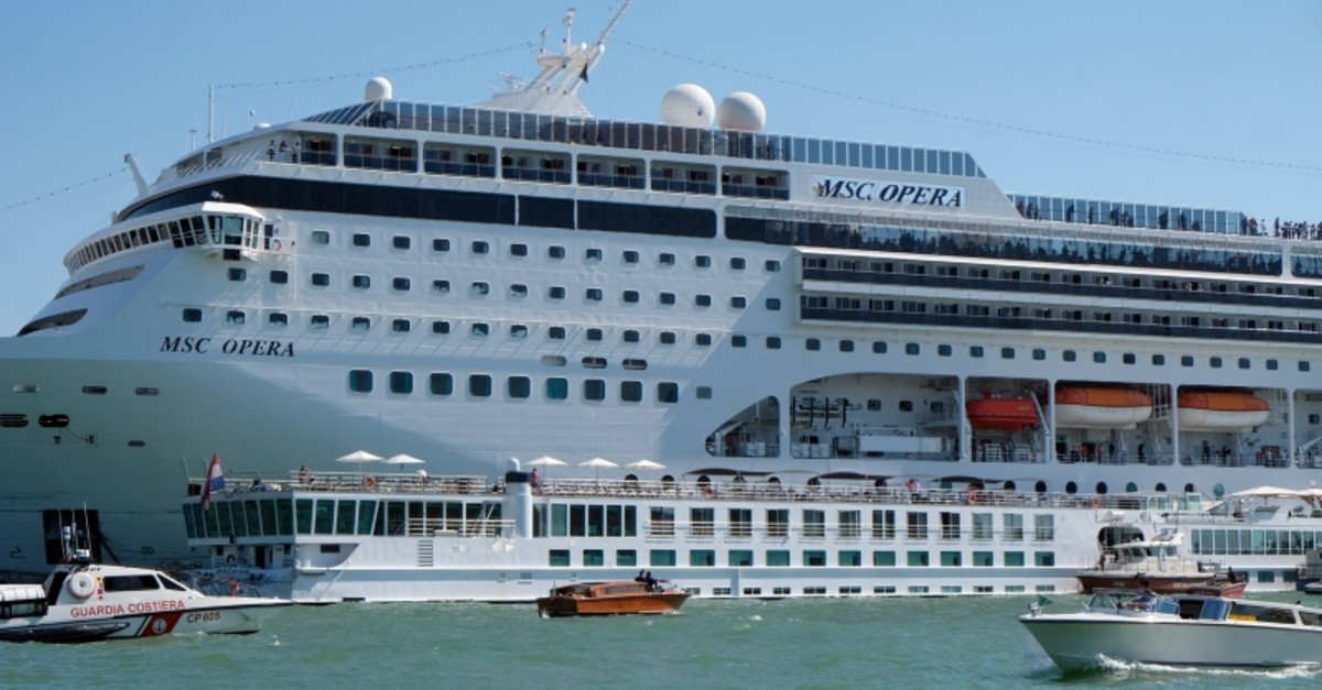 MSC cruise ship loses control and crashes against a smaller tourist boat at the San Basilio dock in Venice, Italy. (Reuters Photo)