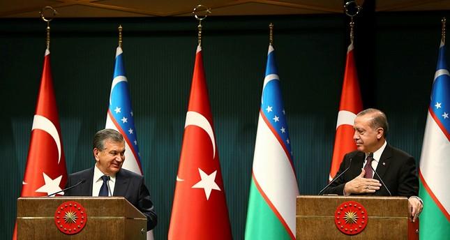 Mirziyoyev (L) and Erdoğan