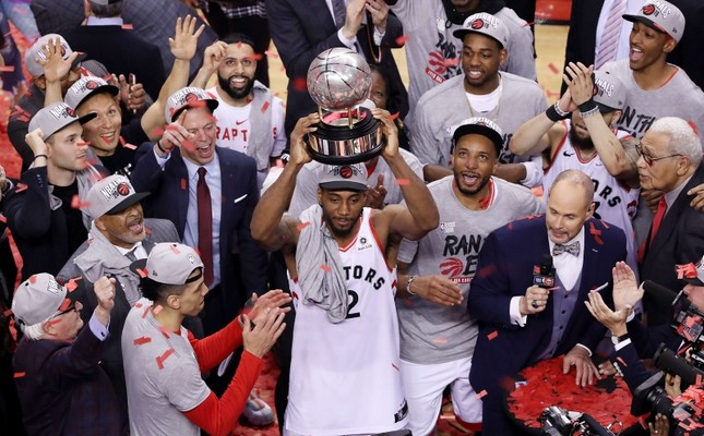 Toronto Raptors' Kawhi Leonard hoists the trophy after the Raptors defeated the Milwaukee Bucks 100-94 in Game 6 of the NBA basketball playoffs Eastern Conference finals Saturday, May 25, 2019, in Toronto. The Canadian Press via AP