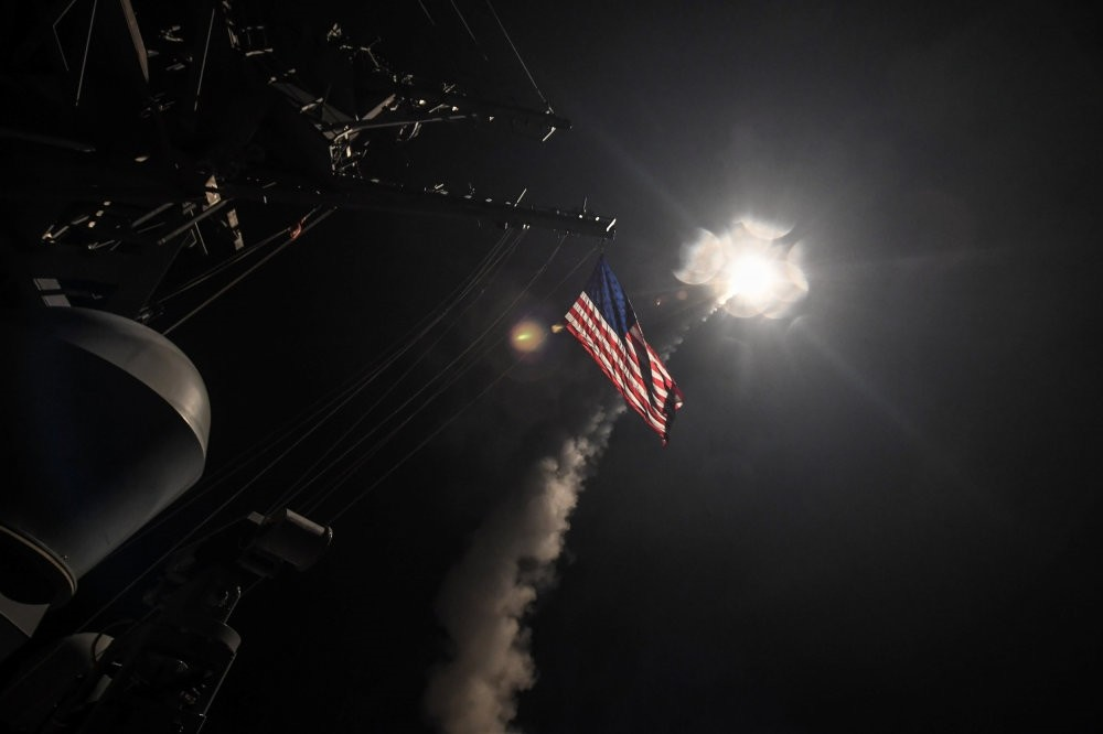 Tomahawk missiles are fired from U.S. warships in the Mediterranean Sea, targeting an air base in retaliation for the Idlib chemical weapons attack by the Assad regime on Tuesday, April 7. (Reuters Photo)