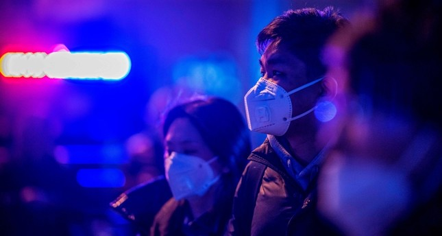 China's virus-hit Wuhan closes transport networks