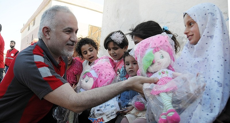Kerem Ku0131nu0131k, President of Turkish Red Crescent, gives toys to orphans at one of the 12 orphanages set up in Syria's Idlib province by the Turkish Red Crescent. (DHA Archive Photo)