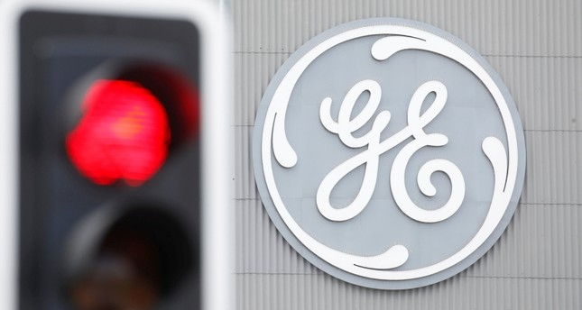 A traffic light is seen in front of a logo of General Electric at the company's plant in Birr, Switzerland June 17, 2019. Reuters Photo