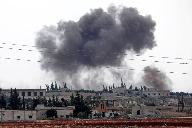 Smoke billows following Assad regime forces' bombardment around the town of Al Habit on the southern edges of the rebel-held Idlib province on Sept. 9, 2018. (AFP Photo)