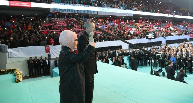 President Recep Tayyip Erdoğan, with first lady Emine Erdoğan, greet AK Party supporters as they arrive at a meeting to announce the party's 11-article manifesto for next month's local election, Ankara, Jan. 31, 2019.