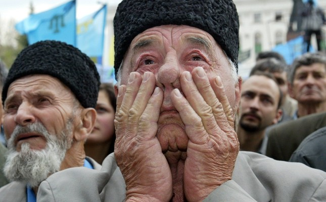 This May 18, 2004 file photo shows a Crimean Tatar man attending a mass rally held on the 60th anniversary of the deportation of the Crimean Tatar people from Crimea. (AFP Photo)