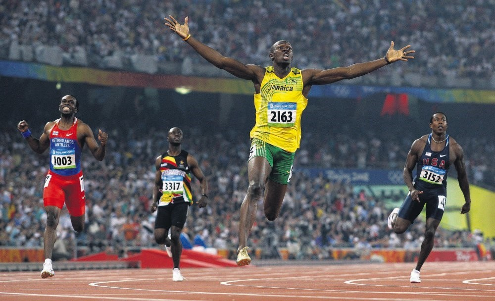 Jamaicau2019s Usain Bolt crosses the finish line to win the gold in the menu2019s 200-meter final at the Beijing 2008 Olympics in Beijing.