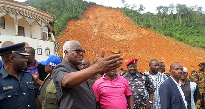 pThe death toll from massive mudslides in Sierra Leone's capital was certain to rise Tuesday as bodies washed up on a beach and workers searched for an untold number of people buried in their...