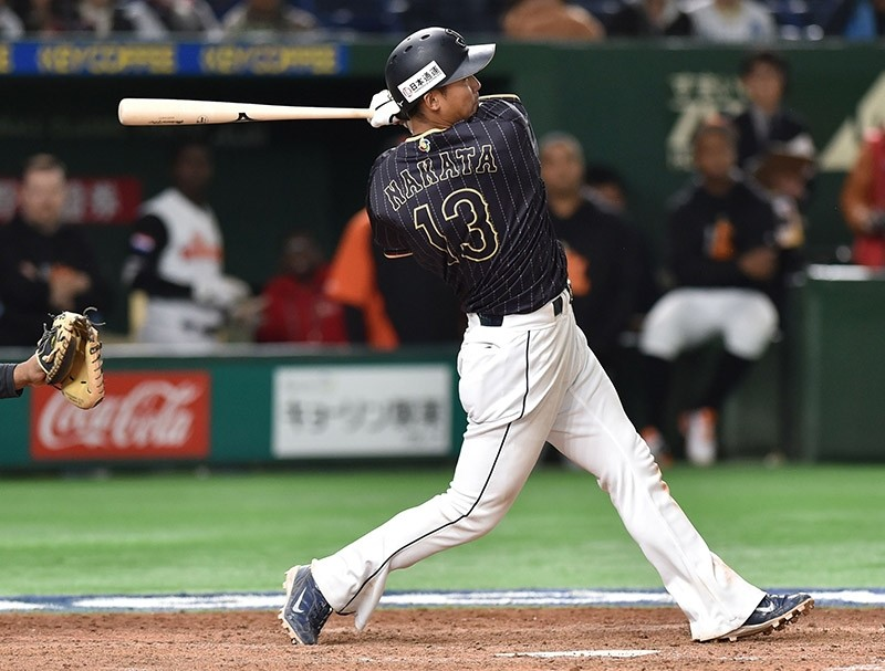 Japan's Sho Nakata hits a single in the top of the 11th inning during the World Baseball Classic Pool E second round match between Japan and Netherlands at Tokyo Dome in Tokyo on March 12, 2017. (AFP Photo)