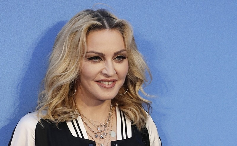 In this Sept. 15, 2016 file photo, Madonna poses for photographers upon arrival at the World premiere of the film ,The Beatles, Eight Days a Week, in London. (AP Photo)