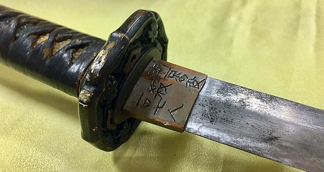This photograph shows a Japanese samurai sword with Chinese script that reads killed 107 people during the war in Nanjing, (China), used August 18 by an attacker that slashed a military police guard at the Presidential Palace in Taipei. (AFP Photo)