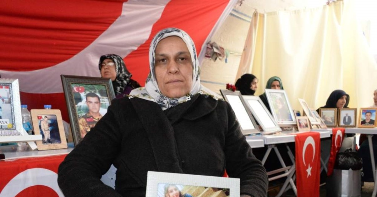 Gevriye Ayhan holds a picture of her daughter Pelda kidnapped by the PKK five years ago, Diyarbak?r, Feb.16, 2020. (DHA)