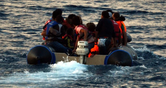 Migrants aboard a boat en route to Greece's island of Kos from Bodrum, a Turkish town on the Aegean Coast. Coastal towns have seen a surge in irregular migrants seeking to reach nearby Greek islands in the past years.