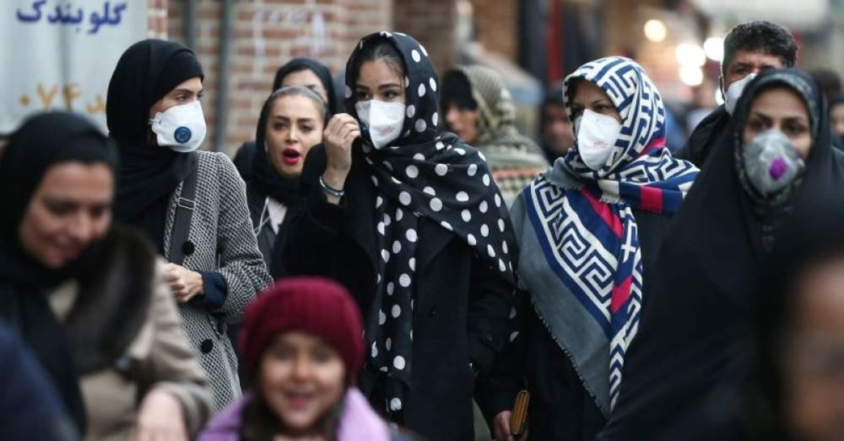 Iranian women wearing protective masks to prevent contracting a coronavirus walk at Grand Bazaar in Tehran, Iran Feb. 20, 2020. (West Asia News Agency/Nazanin Tabatabaee via Reuters)