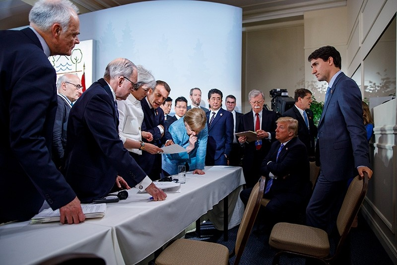 Canada's Prime Minister Justin Trudeau and G-7 leaders including U.S. President Donald Trump discuss the joint statement on the second day of the G-7 meeting in Charlevoix city of La Malbaie, Quebec, Canada, June 9, 2018. (Reuters Photo)