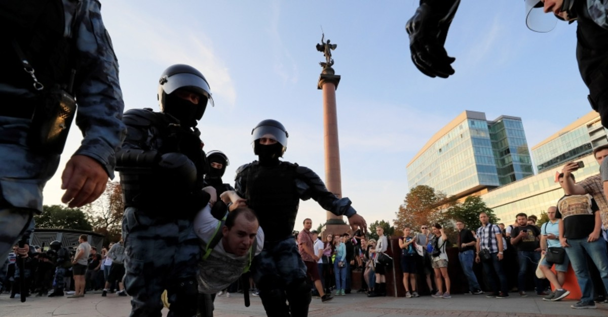 Law enforcement officers detain a participant of a rally calling for opposition candidates to be registered for elections to Moscow City Duma, the capital's regional parliament, in Moscow, Russia July 27, 2019 (Reuters Photo)