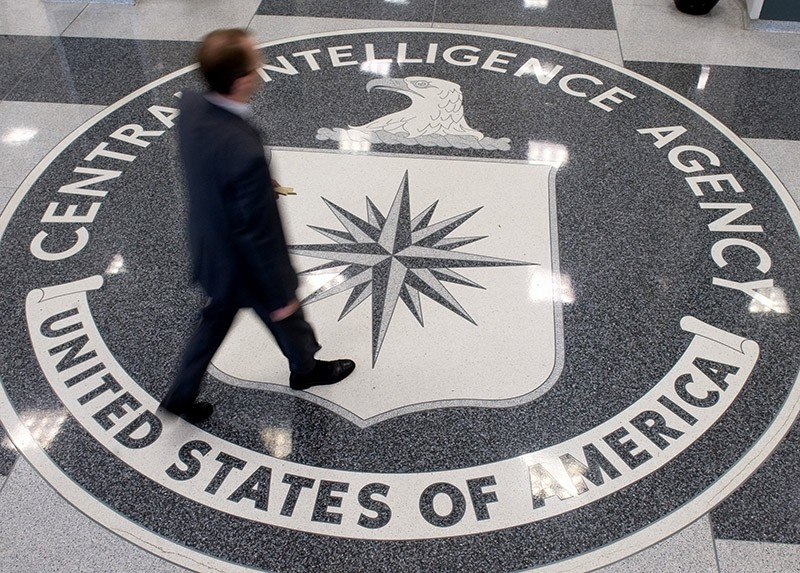 A man crosses the Central Intelligence Agency (CIA) logo in the lobby of CIA Headquarters in Langley, Virginia, on August 14, 2008. (AFP Photo)