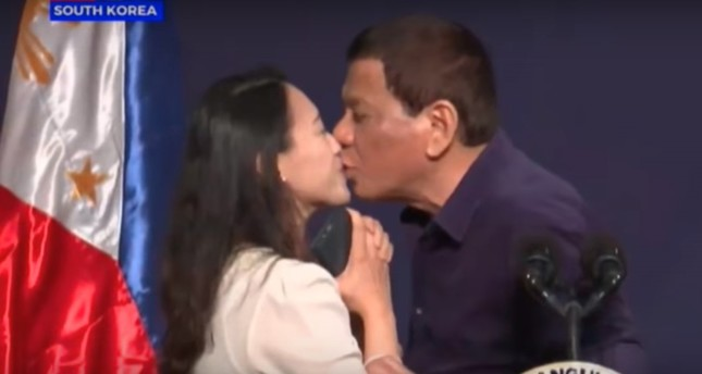 duterte takes heat for kissing filipino woman onstage daily sabah