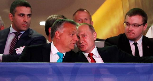 Russian President Vladimir Putin and Hungarian Prime Minister Viktor Orban talk as they attend the Suzuki World Judo Championship in Budapest, Hungary Reuters Photo