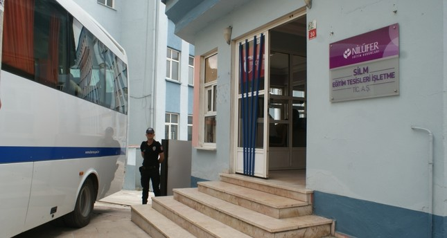 A police officer stands outside a Gülen-linked school after a raid in the western city of Bursa.