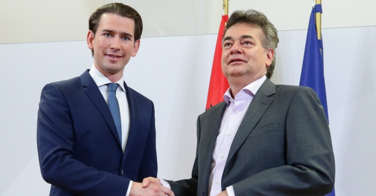 Leader of Austria's Green Party Werner Kogler and head of People's Party (OeVP) Sebastian Kurz shake hands after delivering a statement, in Vienna, Austria January 1, 2020. (Reuters Photo)