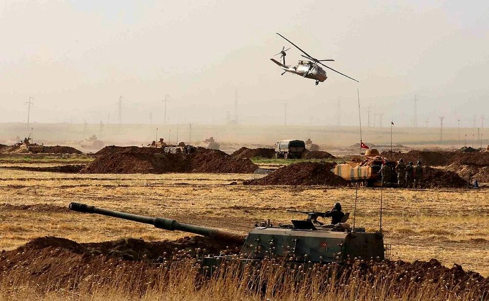 A Turkish military helicopter flies near the Habur border gate between Turkey and the Iraqi Kurdish region in u015eu0131rnak province, Turkey. (AA Photo)