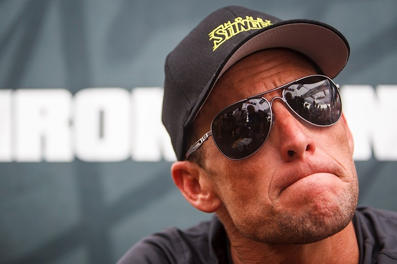 In this April 1, 2012 file photo, Lance Armstrong listens during a news conference in Galveston, Texas. (AP Photo)