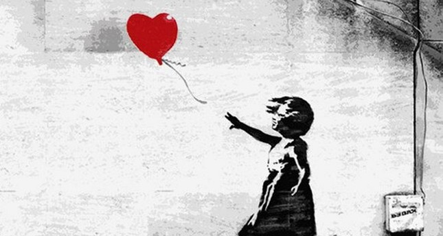 Banksy has garnered global attention with the striking themes of his unique street art created on walls in various countries. (FILE Photo)