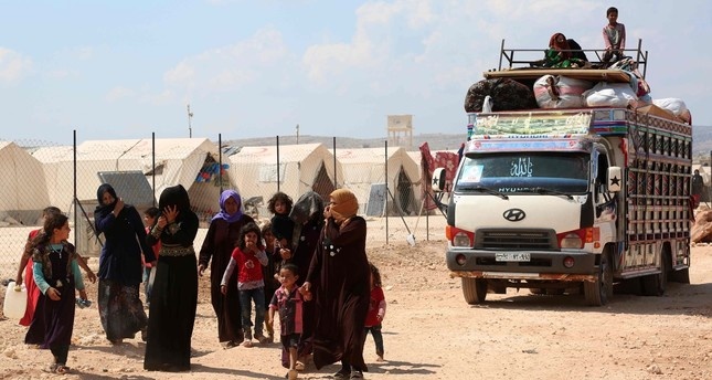 Displaced Syrians arrive with their belongings to a camp in Kafr Lusin, near the border with Turkey in the northern part of Syria's Idlib province, Sept. 9.
