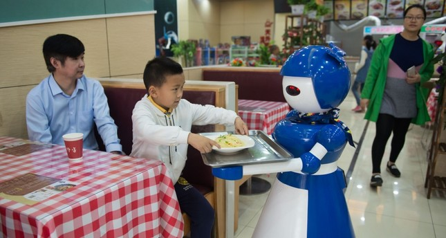 A new cafe in China is running its restaurant with  robots as employees. Located in Kunshan, eastern China, the restaurant relies on over a dozen machines for tasks such as greeting customers, waiting on tables and cooking basic meals.