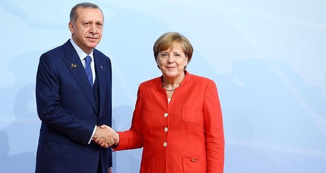 أردوغان وميركل يؤكدان حماية وحدة الأراضي السورية