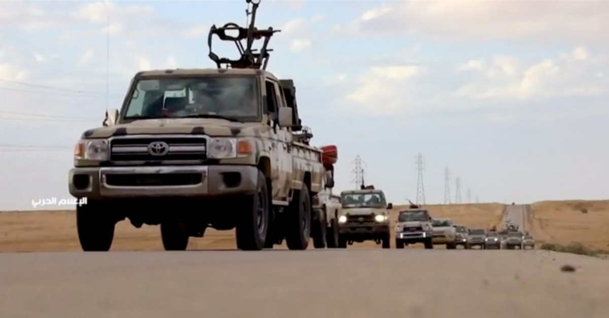 Pickup trucks with mounted weapons drive on a road in Libya, April 4, 2019, in this still image taken from video. (Reuters TV via REUTERS)