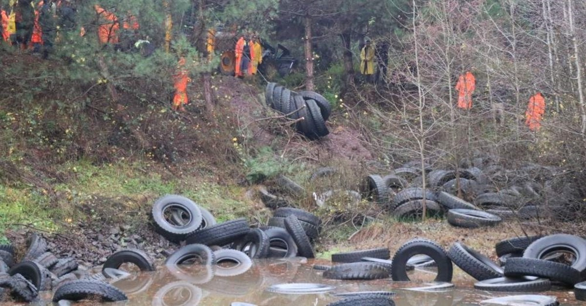 The abandoned tires were collected from the pond in Istanbul's ?ile district earlier this week. (DHA Photo)