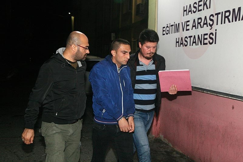 Police bringing one of the PKK suspects to Haseki Hospital for routine health check up in Istanbul, Nov. 1, 2017 (Sabah Photo)