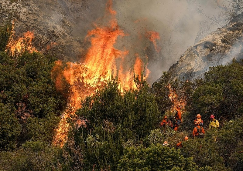 A crew with California Department of Forestry and Fire Protection (Cal Fire) battles a brushfire on the hillside in Burbank, Calif., Saturday, Sept. 2, 2017. (AP Photo)