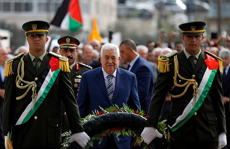 Palestinian President Mahmoud Abbas arrives to lay a wreath on the tomb of late Palestinian leader Yasser Arafat during a ceremony marking the 14th anniversary of Arafat's death, in Ramallah, in the occupied West Bank, Nov. 11, 2018. (Reuters Photo)