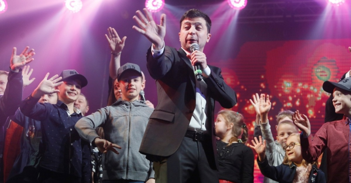 In this file photo taken on Friday, March 29, 2019, Volodymyr Zelenskiy, Ukrainian actor and candidate in the upcoming presidential election, hosts a comedy show at a concert hall in Brovary, Ukraine (AP Photo)