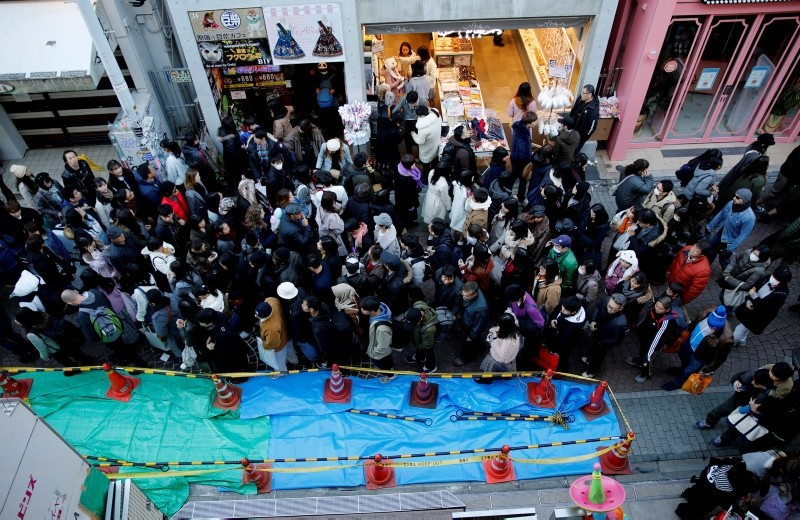 Pedestrians walk past a site where a vehicle ploughed into crowds celebrating New Year's Day in a popular tourist area of Harajuku in Tokyo, Japan (Reuters Photo)