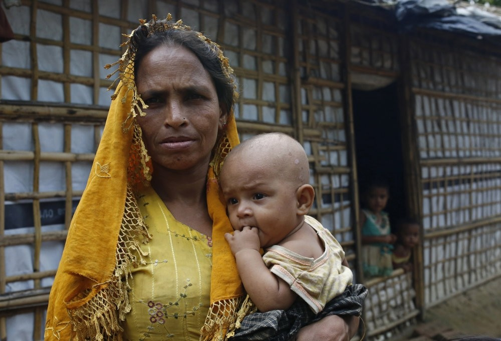 A Rohingya mother holds her child at a makeshift camp in Teknuf, Cox's Bazar, Aug. 24.