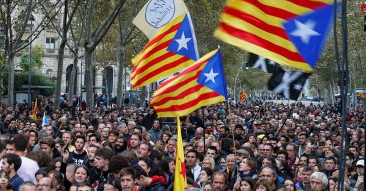 Catalan protesters gather on the eve of the general elections, at University Square in Barcelona, Spain, Nov. 9, 2019.