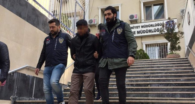 Police officers escort members of a gang of robbers who called themselves Ninja Turtles, Istanbul, Dec. 18, 2019. Photo by Emir Somer