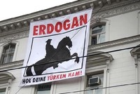 Members of a far-right group hung a banner reading
